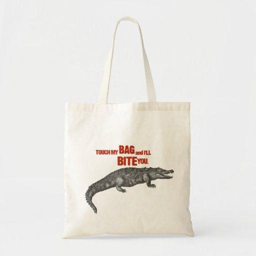 Touchez mon sac et je vous mordrai