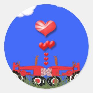 Tracteur rouge avec l'autocollant de joint