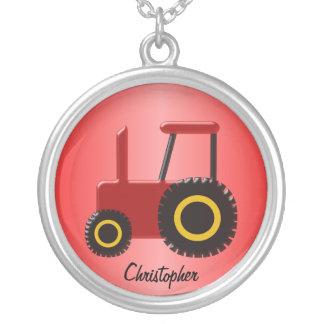 Tracteur rouge collier