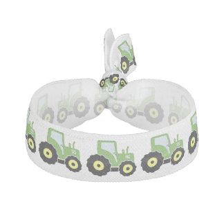 Tracteur vert de jouet élastique pour cheveux