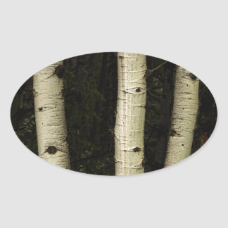 Trois piliers de la forêt sticker ovale