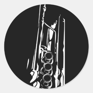 Trompette abstraite de jazz en silhouette adhésif rond