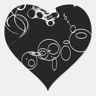Trou dans un sticker cœur