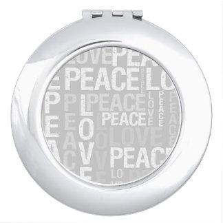 Typographie grise d'amour et de paix miroir de poche