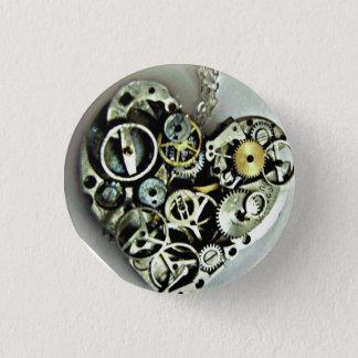 Un bouton de coeur de rouages badges