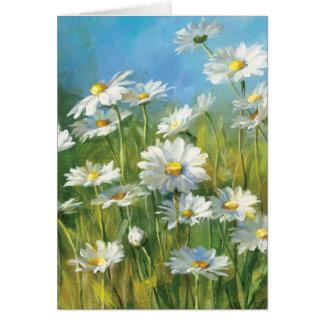 Un champ des marguerites blanches carte de vœux