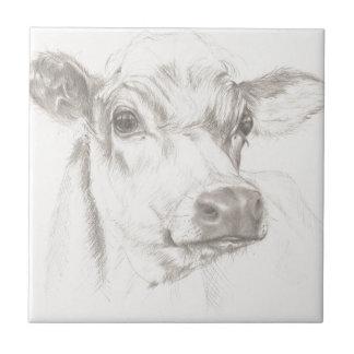 Un dessin d'une jeune vache carreau