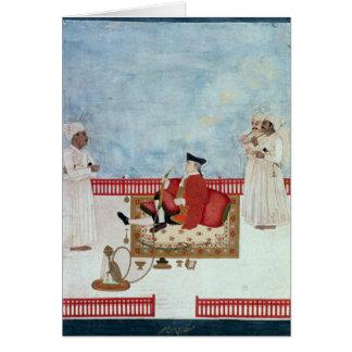 Un Européen assis sur une terrasse avec des Carte De Vœux
