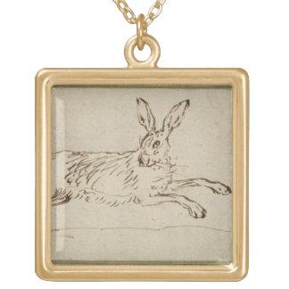 Un fonctionnement de lièvres, avec des oreilles pi collier plaqué or