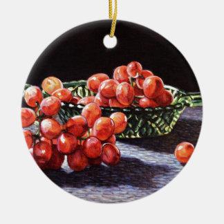 Un groupe de raisins rouges ornement rond en céramique