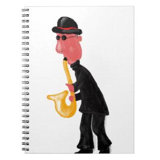 Un homme jouant le saxophone carnets à spirale
