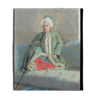 Un monsieur assis sur un divan étuis iPad folio