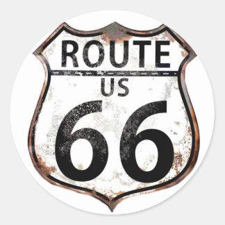 Un panneau routier vintage de l'itinéraire 66 sticker rond