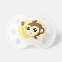 Un singe très mignon et de kawaii tenant une banan tétines