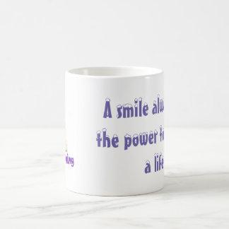 Un sourire a toujours la puissance de changer une mug