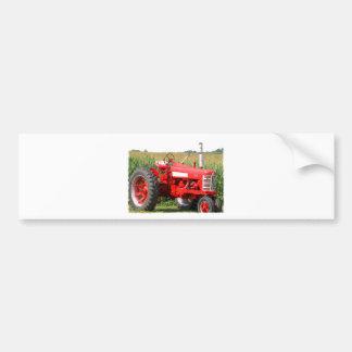 Un tracteur rouge autocollant de voiture