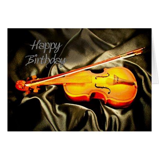 Une carte d'anniversaire musicale avec un violon