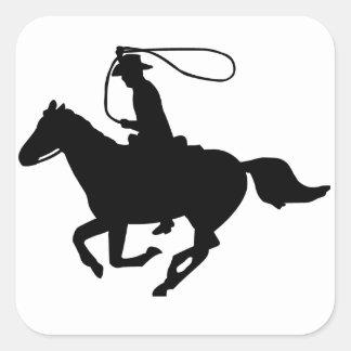 Une équitation de cowboy avec un lasso. sticker carré