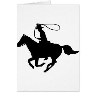 Une équitation de cowboy avec un lasso. cartes de vœux