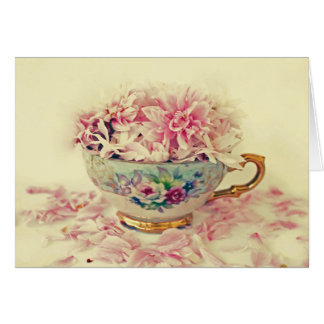 Une tasse de thé vintage de fleurs cartes