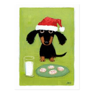 Vacances de lait et de teckel de biscuits carte postale