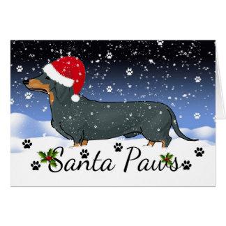 Vacances d'hiver de pattes de Père Noël de teckel Carte De Vœux
