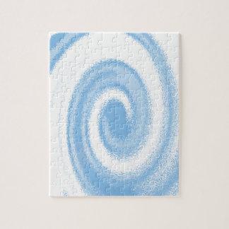 Vague en spirale graphique bleue et blanche de puzzles