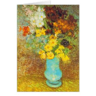 Vase avec les marguerites et la copie d'anémones carte de vœux