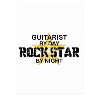 Vedette du rock de guitariste par nuit cartes postales