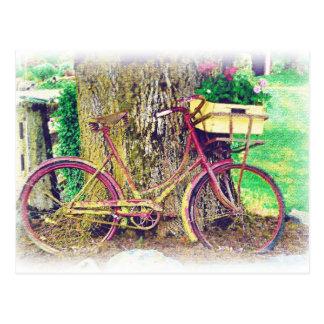 Vélo antique avec le panier de fleur cartes postales
