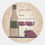 Verres et raisins à bouteilles de vin rouge adhésif rond