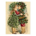 Vieux enfants de houx de mode embrassant Noël Cartes Postales