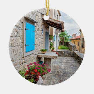 Ville de vieille vue pavée en cailloutis de rue de ornement rond en céramique