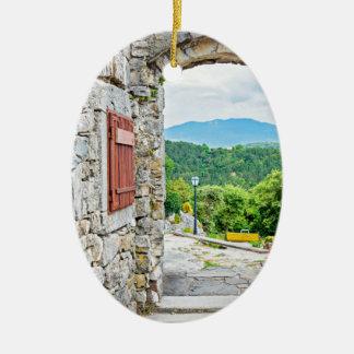 Ville de vue de porte et de rue de pierre de ornement ovale en céramique
