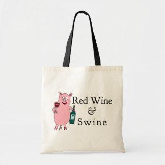 Vin rouge et porcs sacs en toile