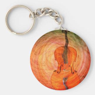 Violoncelle surréaliste avec les notes musicales porte-clé rond