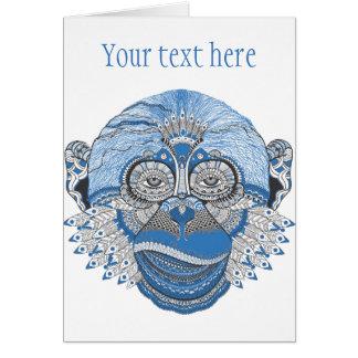 Visage bleu de singe avec le motif et les plumes cartes