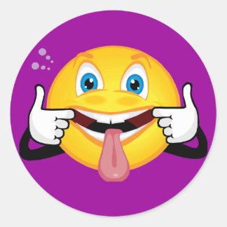 Visage de fabrication souriant sticker rond