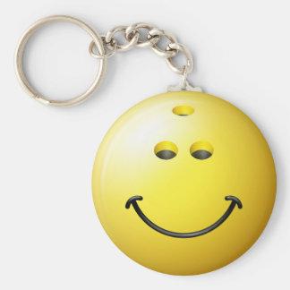 Visage de smiley de boule de bowling porte-clé