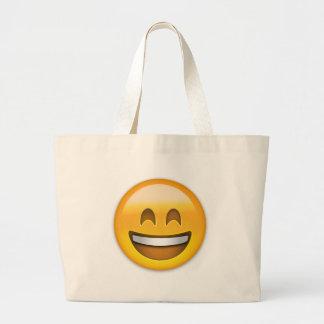 Visage de sourire avec la bouche ouverte et yeux grand sac