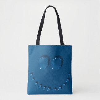 Visage de sourire fait de waterdrops sur un bleu tote bag