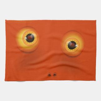 Visage drôle orange de monstre serviette éponge