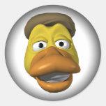 Visage jaune de smiley de visage de canard adhésifs ronds