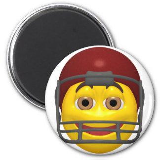 Visage jaune de smiley du football magnet rond 8 cm