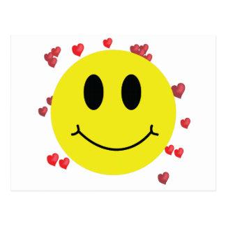 Visage souriant avec les coeurs rouges carte postale