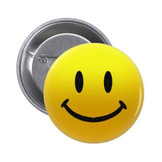 visage souriant badge