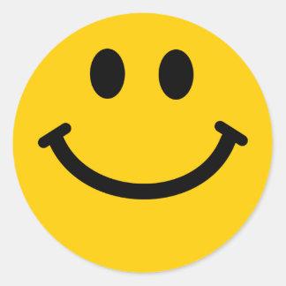 Visage souriant jaune sticker rond