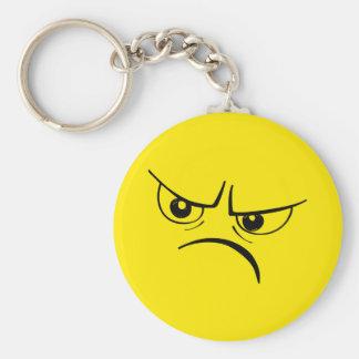 Visage souriant jaune fâché porte-clé rond
