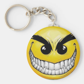 Visage souriant mauvais porte-clé rond