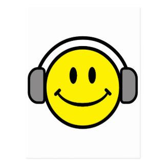 visage souriant mignon avec des écouteurs cartes postales